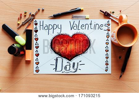 white sheet painted with a red heart with lots of stationary objects. Valentine's Day.