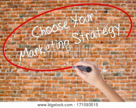Woman Hand Writing Choose Your Marketing Strategy With Black Marker On Visual Screen