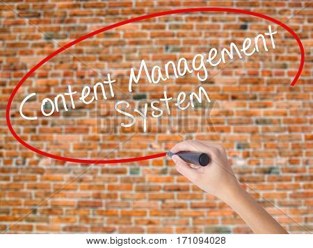 Woman Hand Writing Content Management System  With Black Marker On Visual Screen