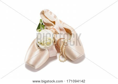 Ballet pointe shoes isolated on white background with white rose