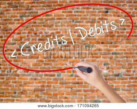 Woman Hand Writing Credits - Debits With Black Marker On Visual Screen.