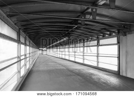 View from the inside to overground pedestrian bridge in monochrome
