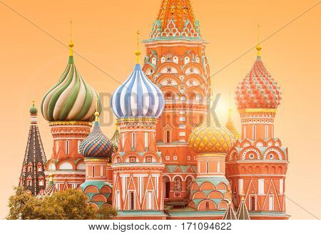 Fragment view of Saint Basil's Cathedral in Moscow with sun on the background