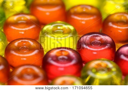 Colorful candy on background with yellow orange and pink sweetmeats candies. Dolce vita. Closeup