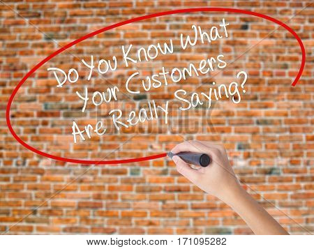 Woman Hand Writing Do You Know What Your Customers Are Really Saying? With Black Marker On Visual Sc