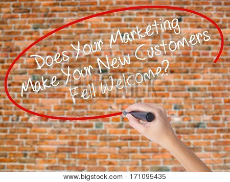 Woman Hand Writing Does Your Marketing Make Your New Customers Fell Welcome?  With Black Marker On V