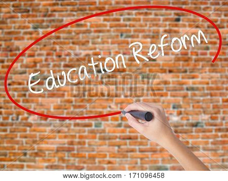 Woman Hand Writing Education Reform With Black Marker On Visual Screen
