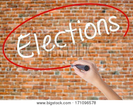 Woman Hand Writing Elections With Black Marker On Visual Screen