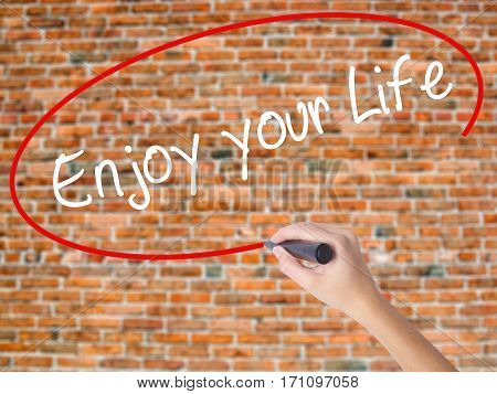 Woman Hand Writing Enjoy Your Life With Black Marker On Visual Screen