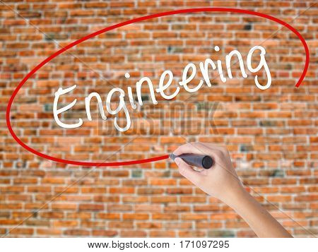 Woman Hand Writing Engineering  With Black Marker On Visual Screen