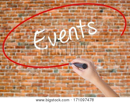Woman Hand Writing Events With Black Marker On Visual Screen