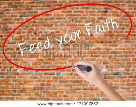 Woman Hand Writing Feed Your Faith With Black Marker On Visual Screen