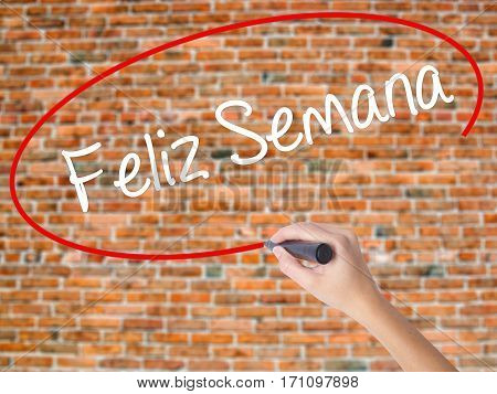 Woman Hand Writing Feliz Semana  (happy Week In Spanish/portuguese) With Black Marker On Visual Scre