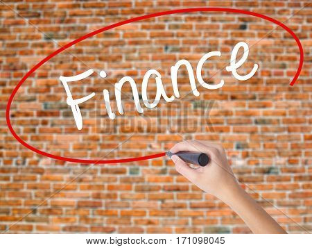 Woman Hand Writing Finance With Black Marker On Visual Screen.