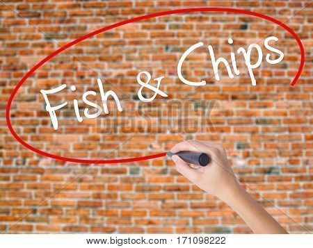 Woman Hand Writing Fish & Chips With Black Marker On Visual Screen