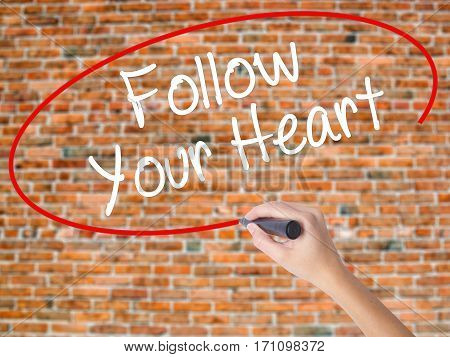 Woman Hand Writing Follow Your Heart With Black Marker On Visual Screen