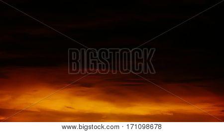Fantastic orange - black sky over the mountains.