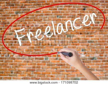 Woman Hand Writing Freelancer With Black Marker On Visual Screen.