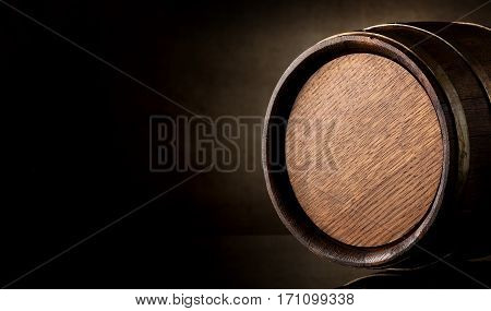Wooden barrel on a background of brown texture