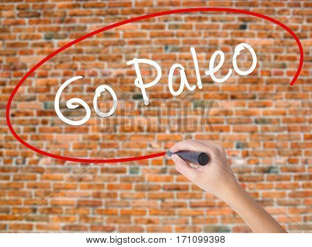 Woman Hand Writing Go Paleo With Black Marker On Visual Screen