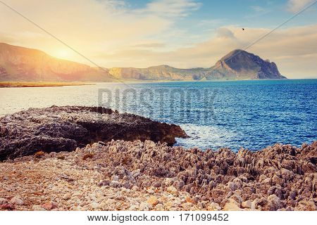 Fantastic view of the nature reserve Monte Cofano. Dramatic scene. Sunset over sea. Location cape San Vito. Sicilia, Italy, Europe. Mediterranean and Tyrrhenian sea.