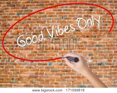 Woman Hand Writing Good Vibes Only  With Black Marker On Visual Screen