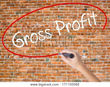 Woman Hand Writing Gross Profit With Black Marker On Visual Screen