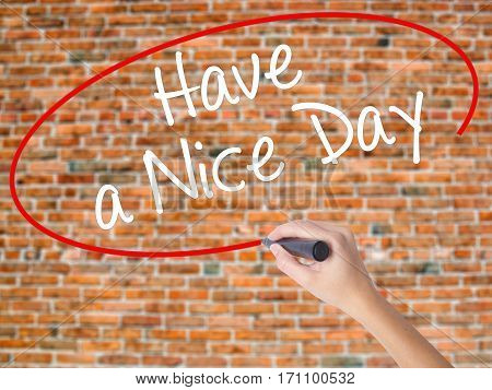Woman Hand Writing Have A Nice Day With Black Marker On Visual Screen