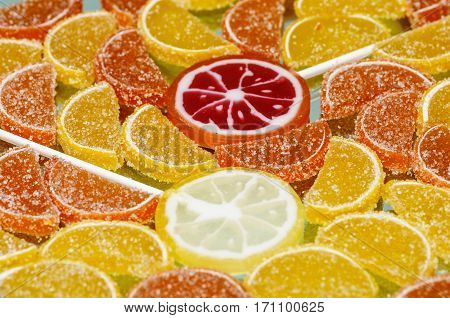 Colorful sugary marmalade like lemon and orange slices with handmade lollipop candies. Dolce vita. Closeup poster