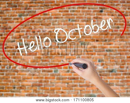 Woman Hand Writing  Hello October  With Black Marker On Visual Screen