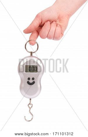 Hand holding a small portable electronic scale isolated on a white background