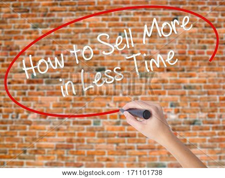Woman Hand Writing How To Sell More In Less Time With Black Marker On Visual Screen.