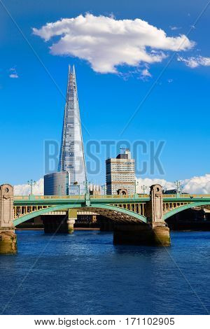 London Southwark bridge and the Shard on Thames river in UK