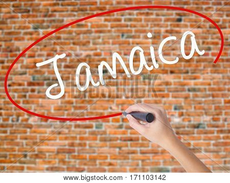 Woman Hand Writing Jamaica  With Black Marker On Visual Screen