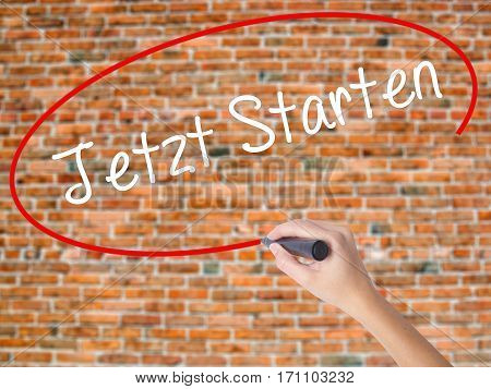 Woman Hand Writing Jetzt Starten (start Now In German) With Black Marker On Visual Screen