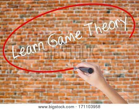 Woman Hand Writing Learn Game Theory With Black Marker On Visual Screen