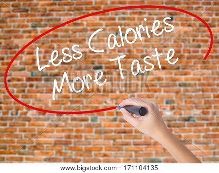 Woman Hand Writing Less Calories More Taste With Black Marker On Visual Screen