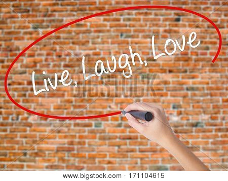 Woman Hand Writing Live Laugh Love With Black Marker On Visual Screen