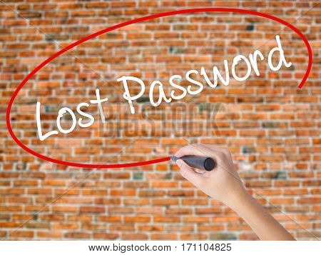 Woman Hand Writing Lost Password  With Black Marker On Visual Screen