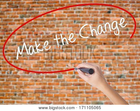 Woman Hand Writing Make The Change With Black Marker On Visual Screen