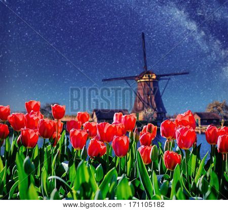 Traditional Dutch windmills from the canal in Rotterdam, deep sky astrophoto. Holland.