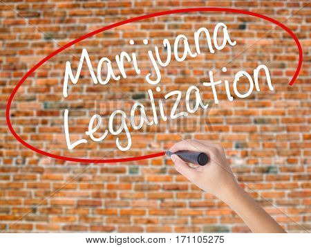 Woman Hand Writing Marijuana Legalization With Black Marker On Visual Screen
