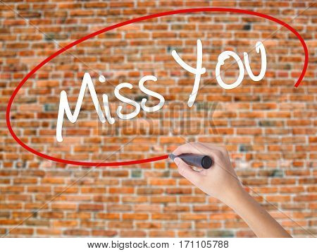 Woman Hand Writing Miss You With Black Marker On Visual Screen