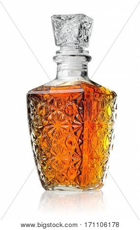Crystal decanter with cognac isolated on white