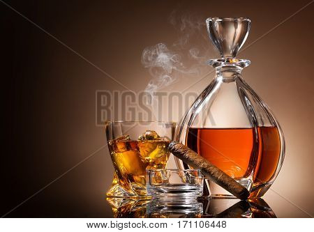 Decanter of whiskey with cigar and glass