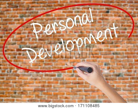 Woman Hand Writing Personal Development  With Black Marker On Visual Screen.