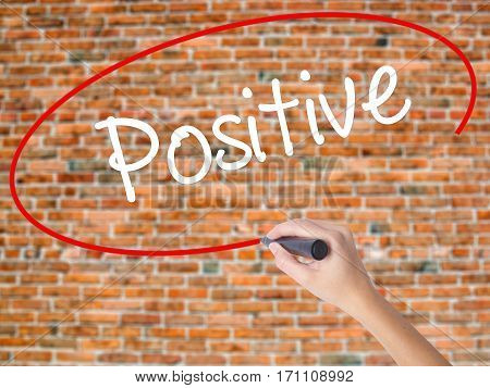 Woman Hand Writing Positive With Black Marker On Visual Screen