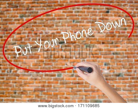 Woman Hand Writing Put Your Phone Down With Black Marker On Visual Screen