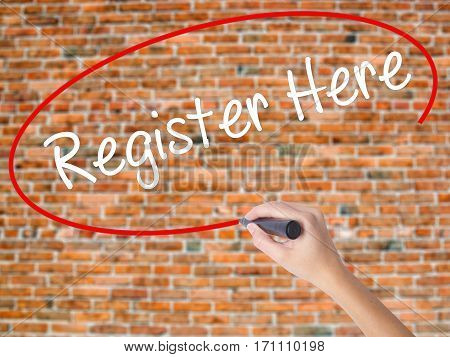 Woman Hand Writing Register Here With Black Marker On Visual Screen