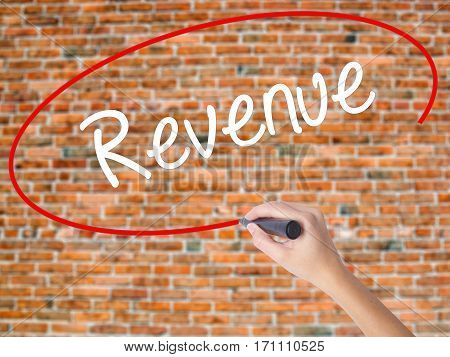 Woman Hand Writing Revenue With Black Marker On Visual Screen